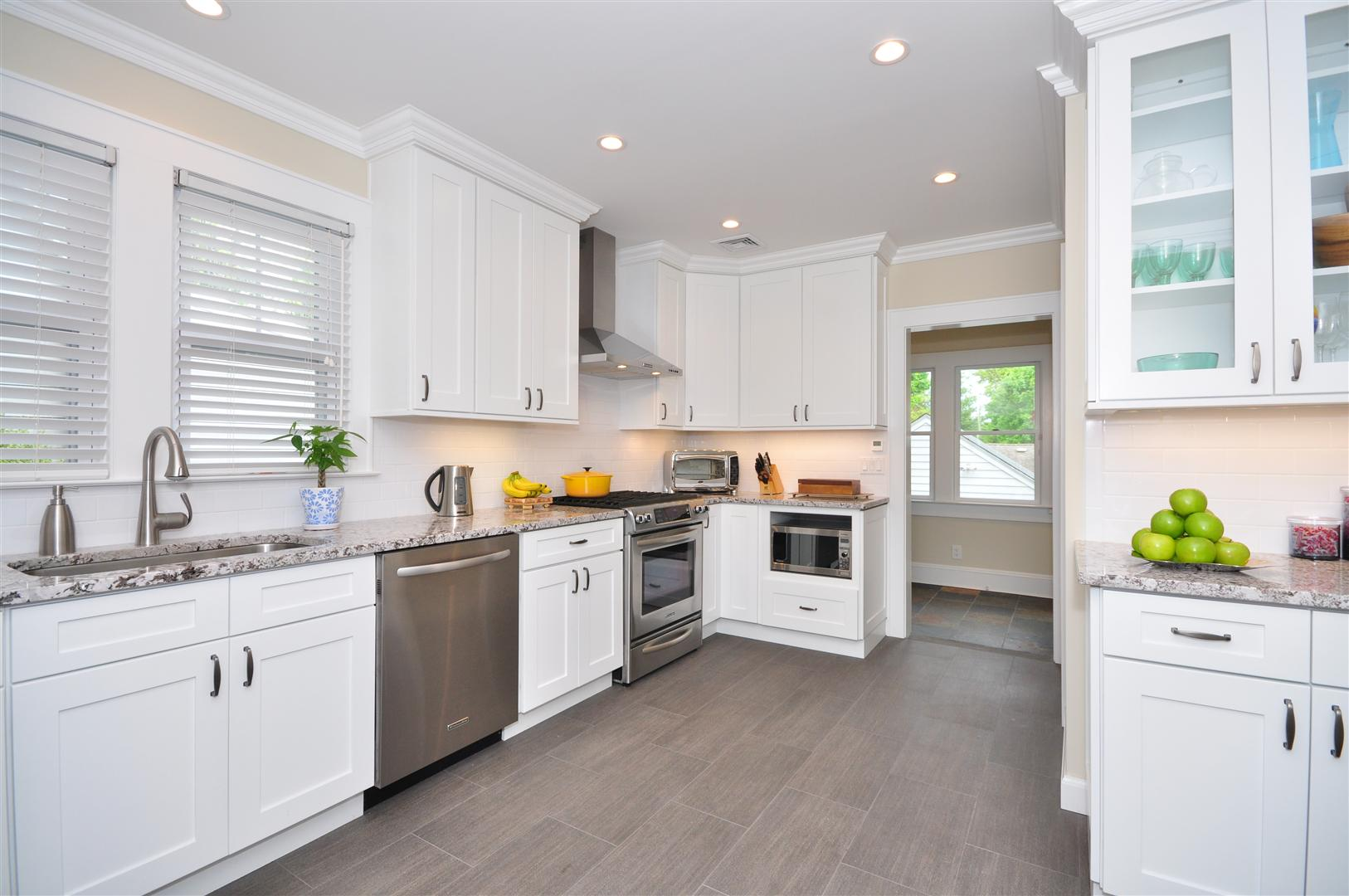 White Kitchen Cabinets with Five-Piece Fronts